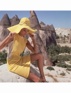 Model in G�reme, Turkey, wearing bright yellow dress with yellow and white striped side panels by Leslie Fay. *** Local Caption ***