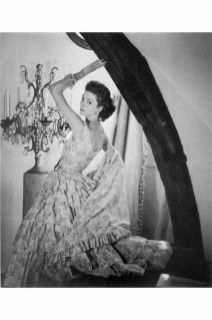 Suzy Parker wearing a gown by Griffe in 1954