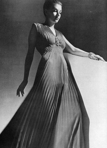 model-is-wearing-coral-crepe-pleated-evening-dress-by-jay-thorpe-with-tiffany-brooch-composed-of-two-diamond-clips-photo-by-hoyningen-huene-harpers-bazaar-jan-1939
