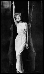 model-in-white-crepe-sheath-artfully-draped-at-the-waist-by-jean-patou-photo-by-georges-saad-1961