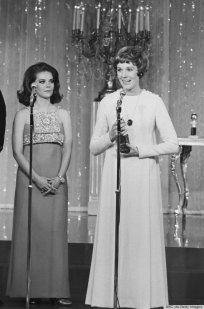 24TH ANNUAL GOLDEN GLOBE AWARDS -- Pictured: (l-r) Actress Natalie Wood and Golden Globe winner of the Henrietta Award Julie Andrews on stage during the 24th Annual Golden Globe Awards at the Cocoanut Grove on February 15, 1967 -- Photo by: Frank Carroll/NBCU Photo Bank