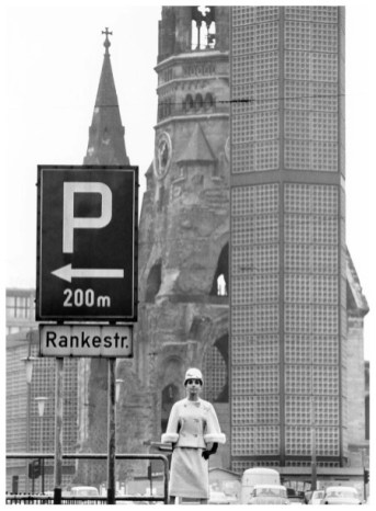 biggi-is-wearing-a-beige-tweed-suit-featuring-sleeves-trimmed-in-a-pale-mink-by-uli-richter-photo-by-f-c-gundlach-in-front-of-the-gedc3a4chtniskirche-1963