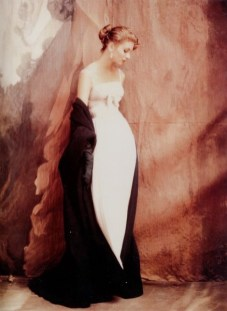 Suzy Parker wears a strapless white chiffon dress, its Empire waist banded with rhinestones, paired with the gloves are emerald green by Jacques Griffe, Vogue October 1953