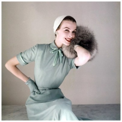 model-in-heller-baby-blue-worsted-jersey-dress-with-satin-bow-at-neck-by-richard-cole-little-felt-hat-by-amy-and-norwegian-blue-fox-muff-by-annis-furs-1952-photo-by-john-rawlings