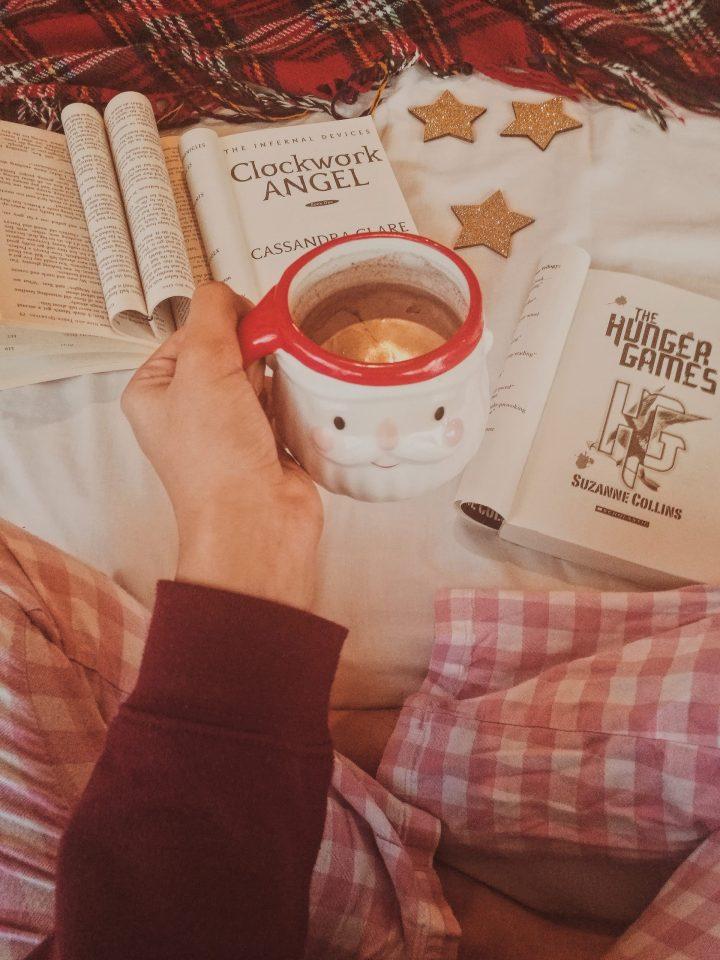 cosy blanket, pjs books, santa mug for blogmas post self care winter pamper night in