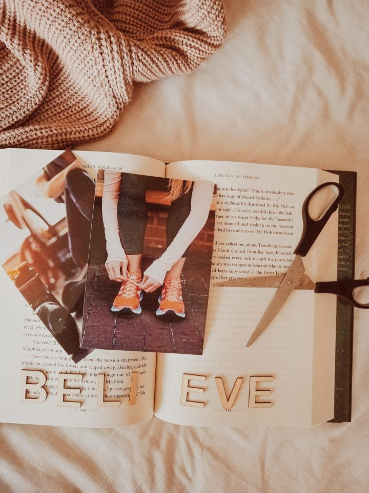 fitness postcards and wooden letters believe and scissors for blogmas post vision board for 2020