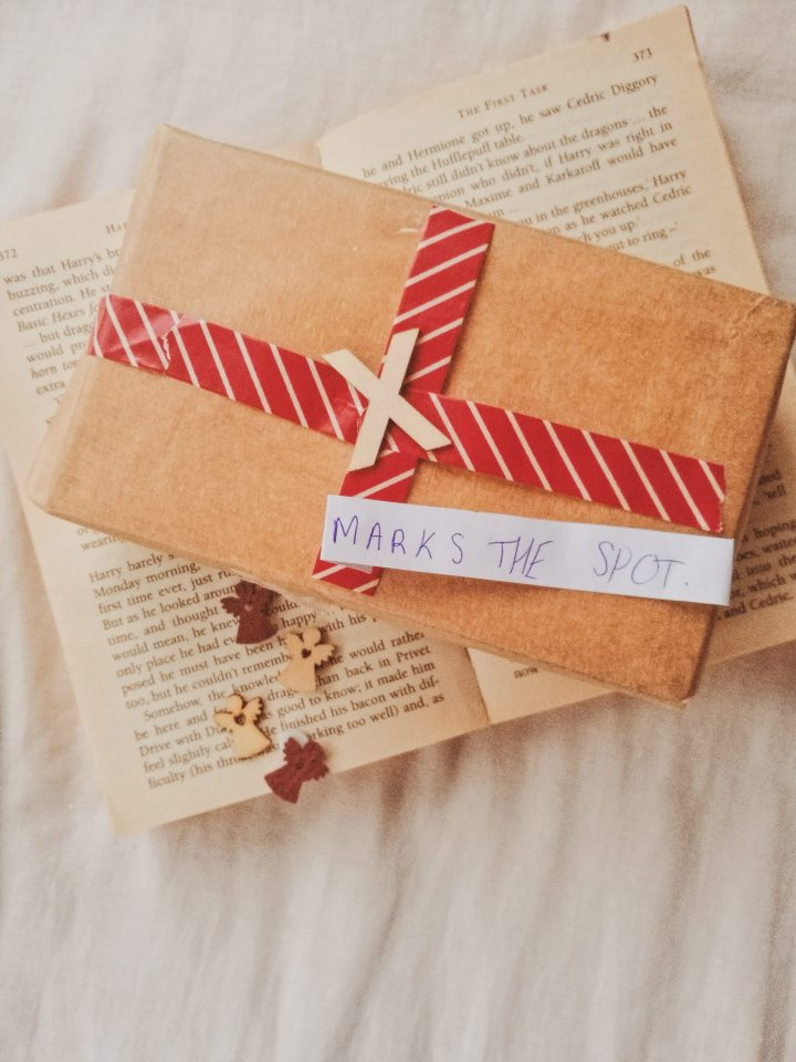 bucket list for the new year with a book and wooden letters X marks the spot