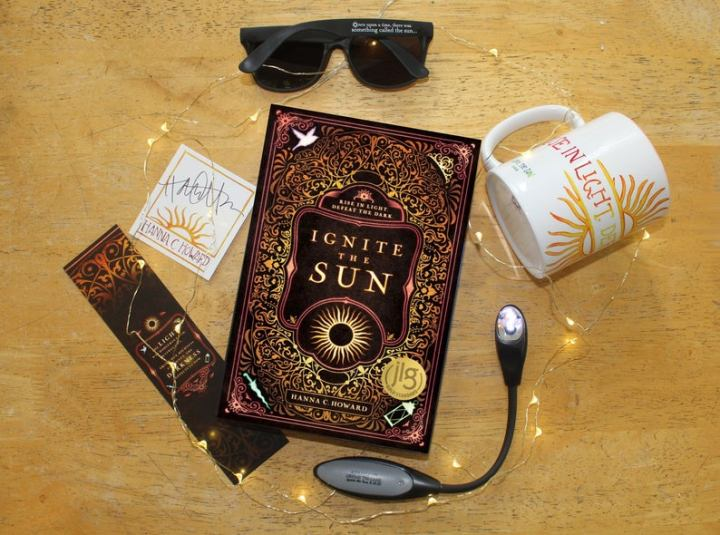 Ignite The Sun by Hanna Howard finished copy of book. Giveaway featuring mug, bookmark and more. Book Blogger, book blog tour, goodreads, ya fantasy