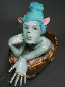 "Sweet Ride, 2009, terracotta, porcelain, fabric, wood, felted wool, cast glass, nylon flock, chain, paint, 25"" x 12"" x 36"""