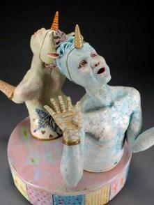 "Back to Back, 2012, stoneware, glaze, underglaze pencil, wood, ribbon, glitter, 17"" x 16"" x 16"""