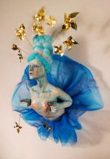 "Self Sufficient, 2013, stoneware, glaze, paint, brass, wire, wool, fabric, 15"" x 12"" x 8"""