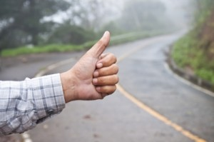 Hitchhiker raising thumb