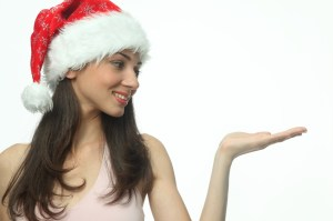 woman in santa hat holding up hand
