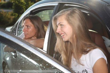 two girls sitting in a car