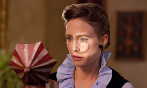 Lorrain Warren looks in the music box in The Conjuring