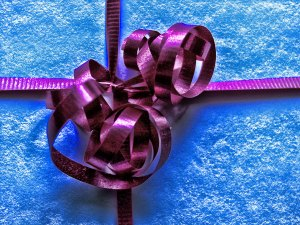 Blue gift with purple ribbon