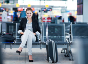 young business woman smiling in the airport