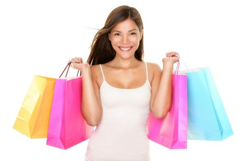 happy woman shopping to reinvent her look