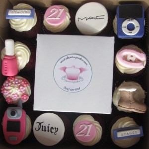 box of cutely designed cupcakes for a birthday