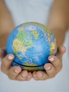 girl holding globe in her hands