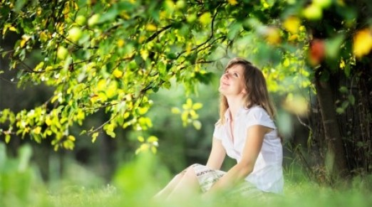 Girl with beautiful spring skin sitting outside