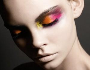 Girl wearing pink, orange, and yellow eye makeup
