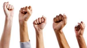 People putting fists in the air