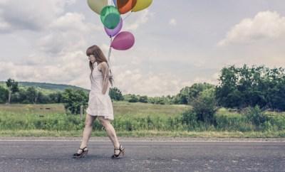 girl walking with balloons