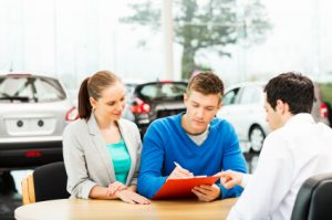 group of people negotiating car price