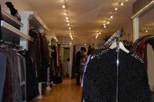 women's clothing hanging in store