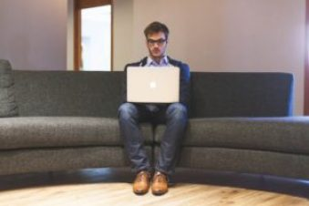 man with laptop Sitting alone will not get you promoted