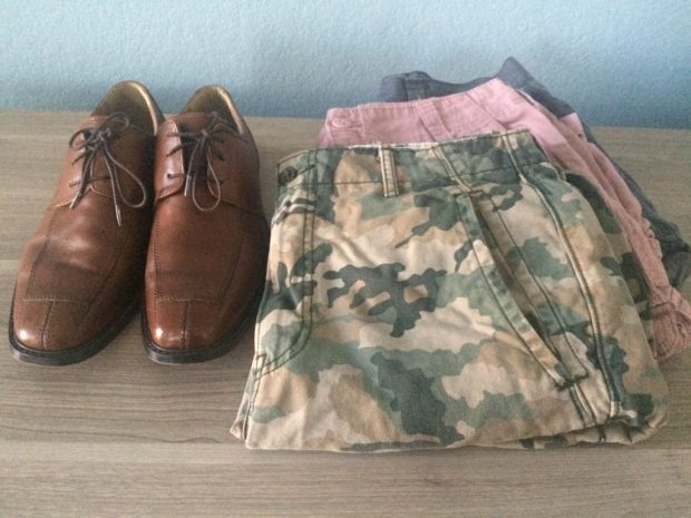 men's shoes and shorts after shopping