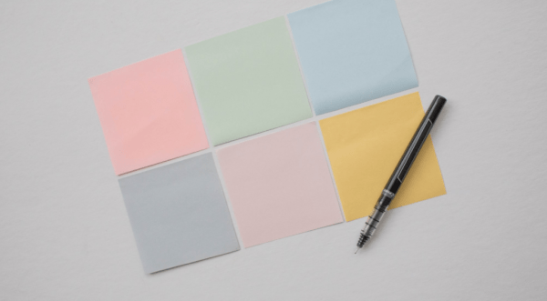 sticky notes and pen