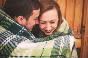 couple hugging in a blanket