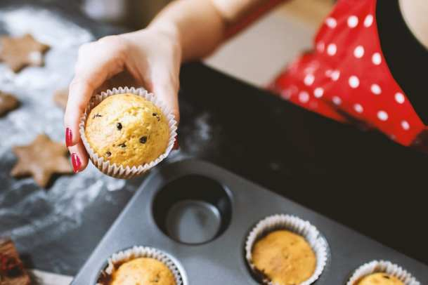 woman holding muffin