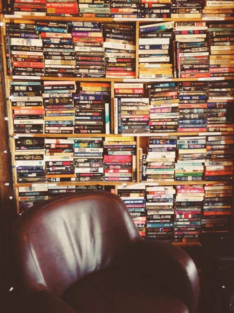 bookshelf and armchair