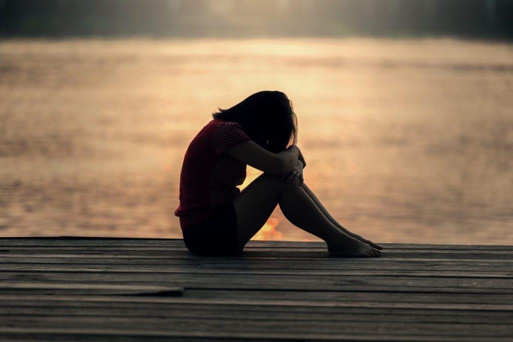 girl crying on dock