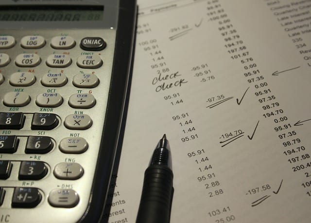 calculator and expenses sheet