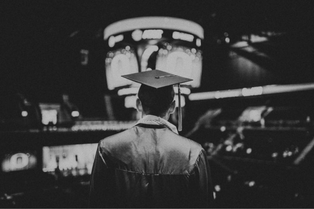 student graduation pays his loan