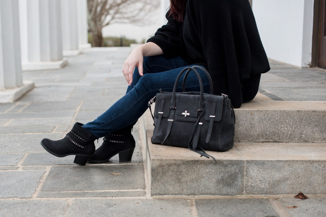 A Black sweater and booties for a wintry day date.