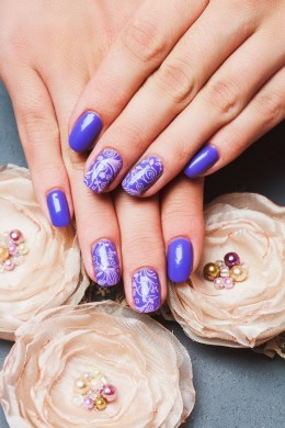 Blue nails with white design
