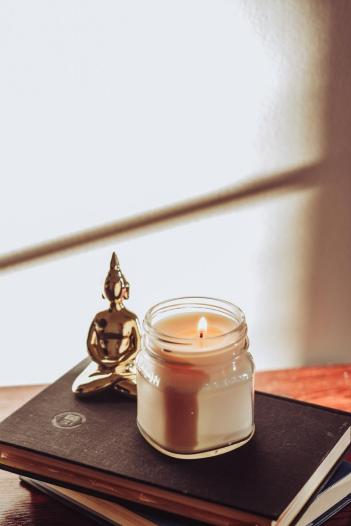 Complete your yoga room decor with a scented  Amber Mason Jar Candle