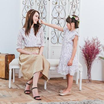 Cute matching outfit mother and daughter