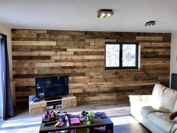 Decorate the walls with wood pallets such as the image bellow