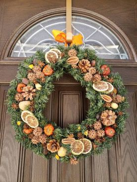 Evergreen Christmas wreath with dried citrus slices