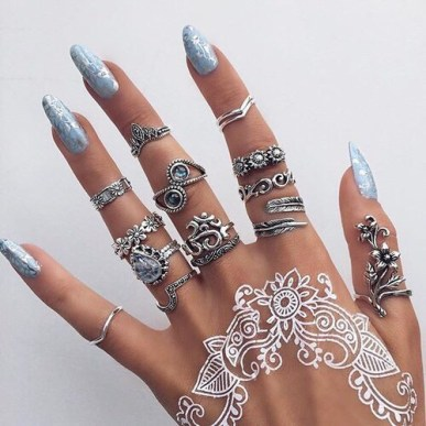 Gorgeous silver rings for completing a henna tattoo at festivals