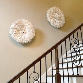 Ivory juju hat wall decor on stairway