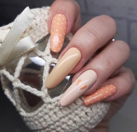 Long Easter peach colour manicure
