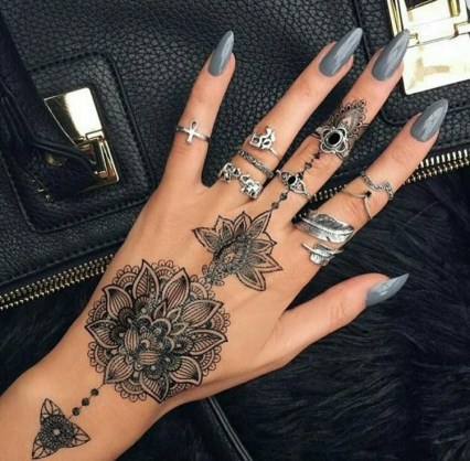 Lotus Flower Henna Tattoo Designs and silver rings