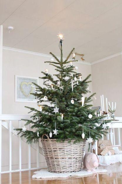 Chic Scandinavian Christmas tree in basket